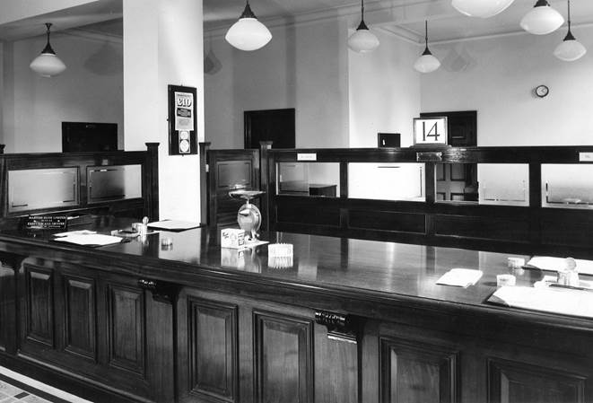 1955 Newton Abbot view of counter, clock with 4-10pm 33-408.jpg