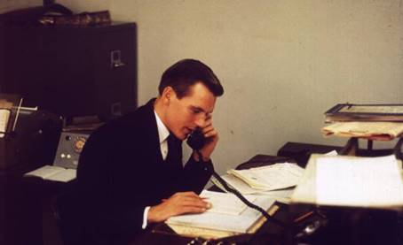 1962 Alan Prime at Dealing desk AP-MBA.jpg